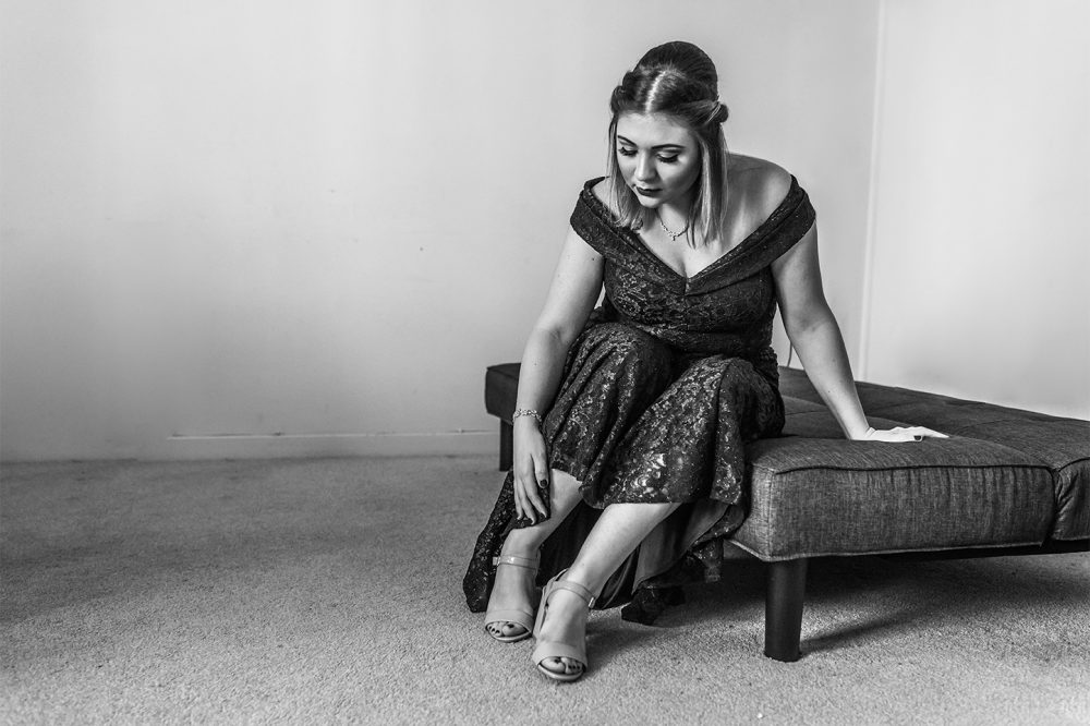 bride getting ready before wedding by documentary wedding photographer in South London and Kent