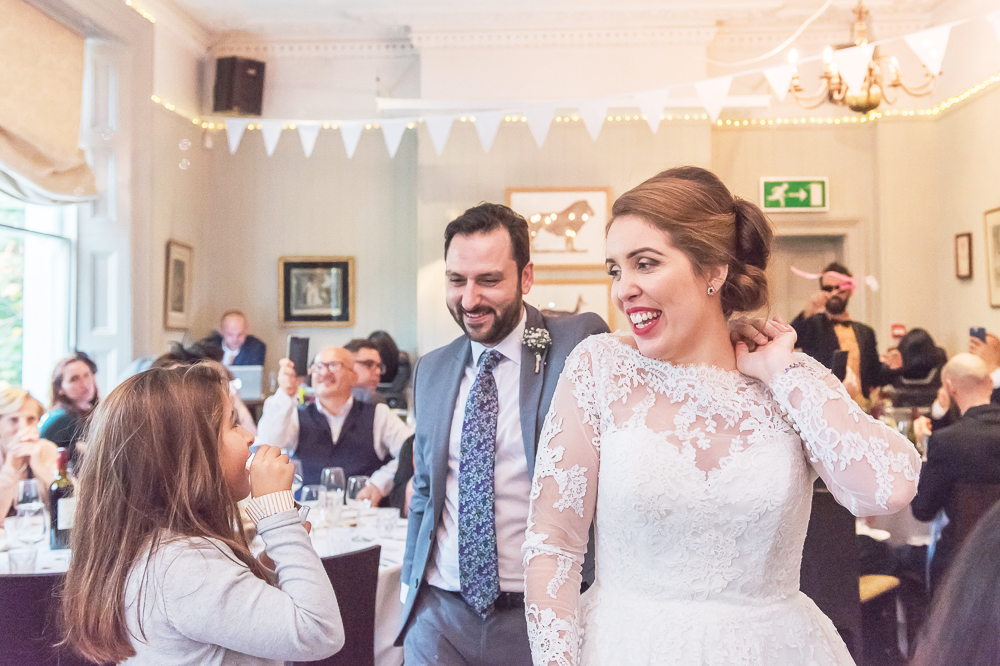 couple arriving at wedding reception by documentary wedding photographer in South London and Kent