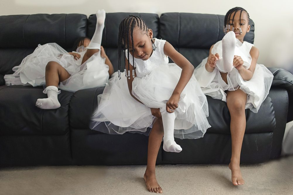 Flower girls getting ready for the wedding by Wedding Photographer South London