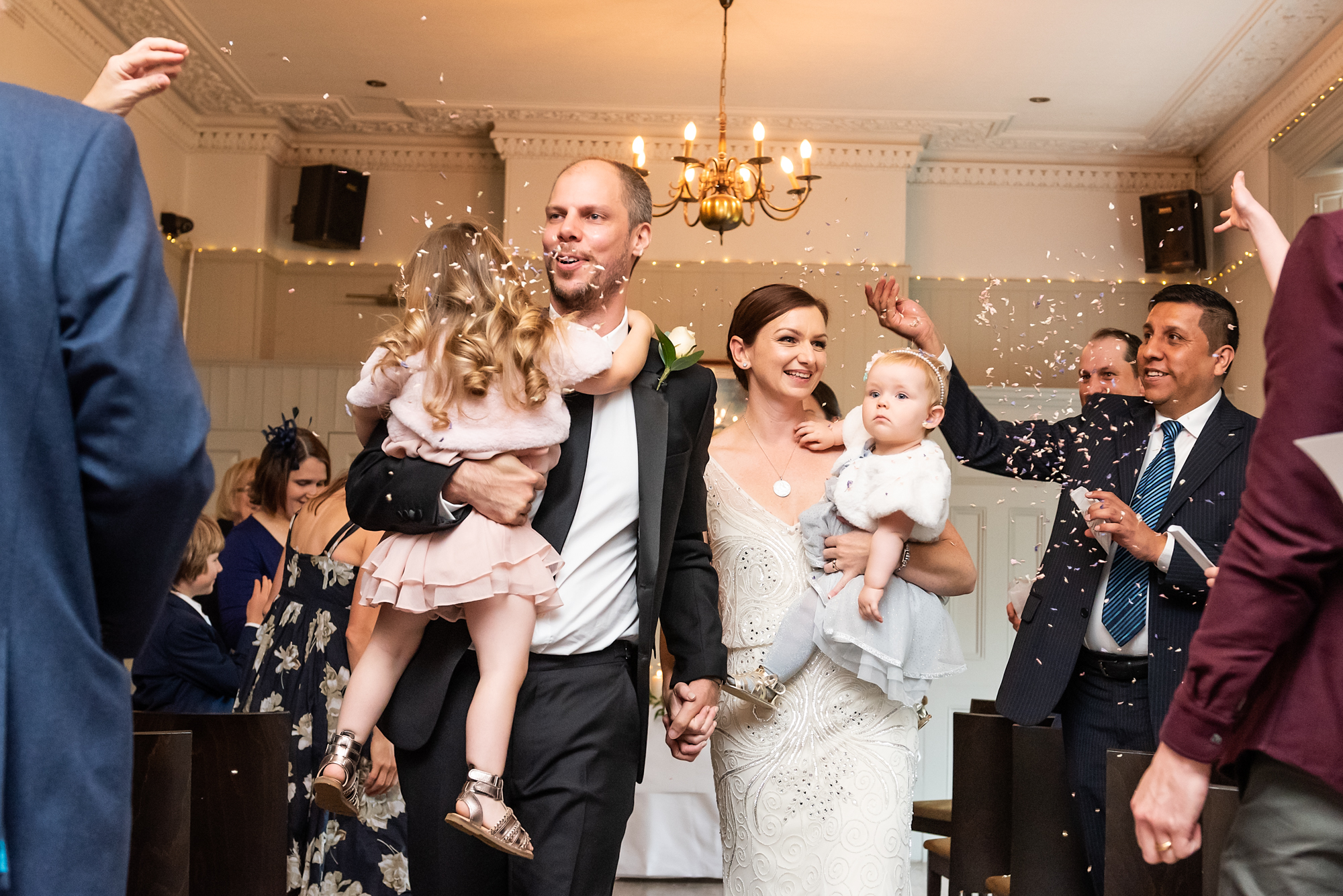 Shot of couple with confetti at The Rosendale Pub in London - Piccolino Weddings