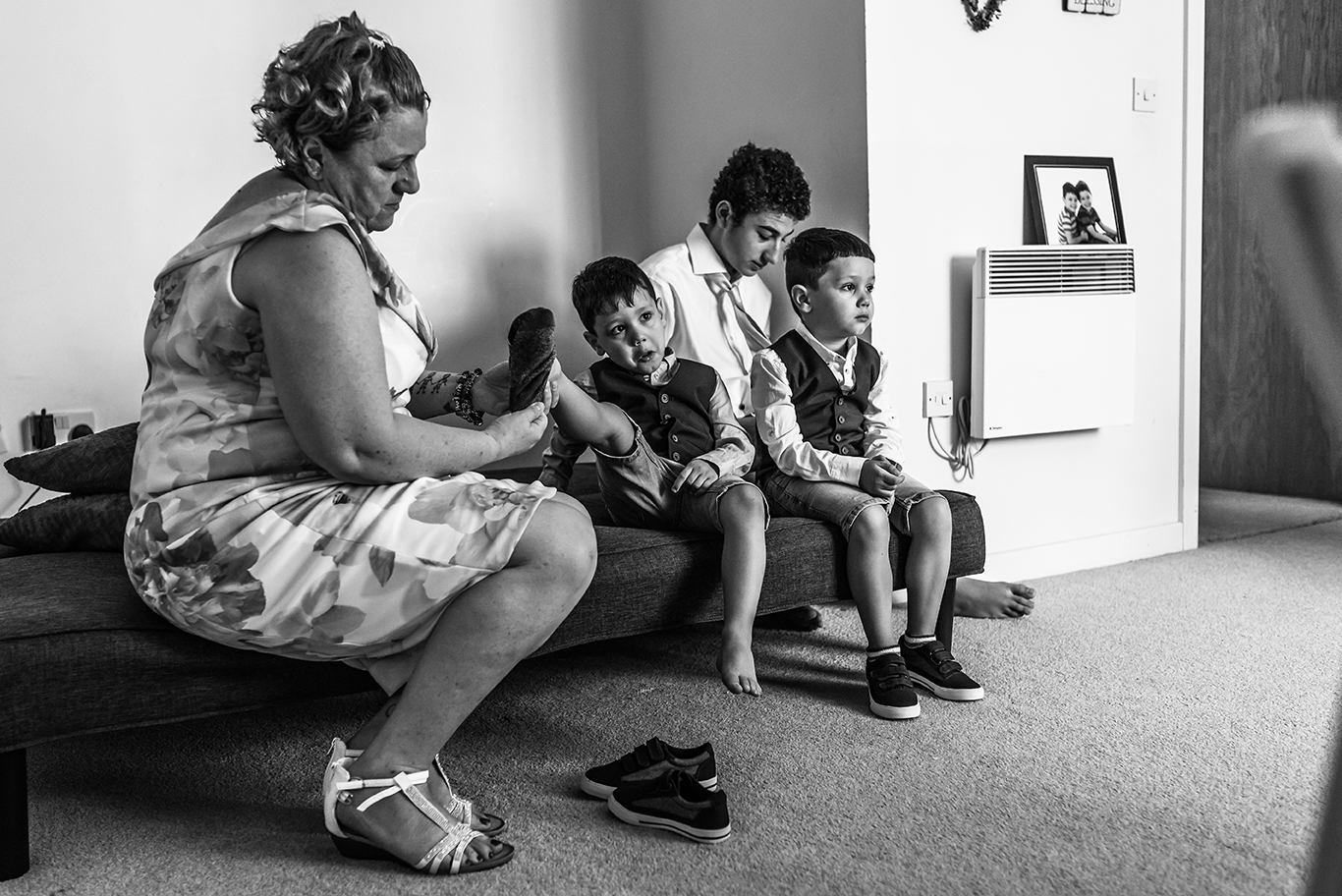 Bride's mum dressing up the kids before the ceremony - South London Wedding Photographer