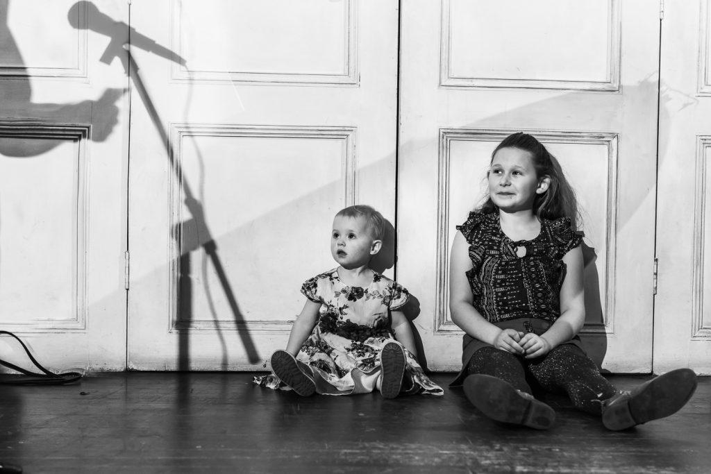 Children listening to the speeches at a wedding reception