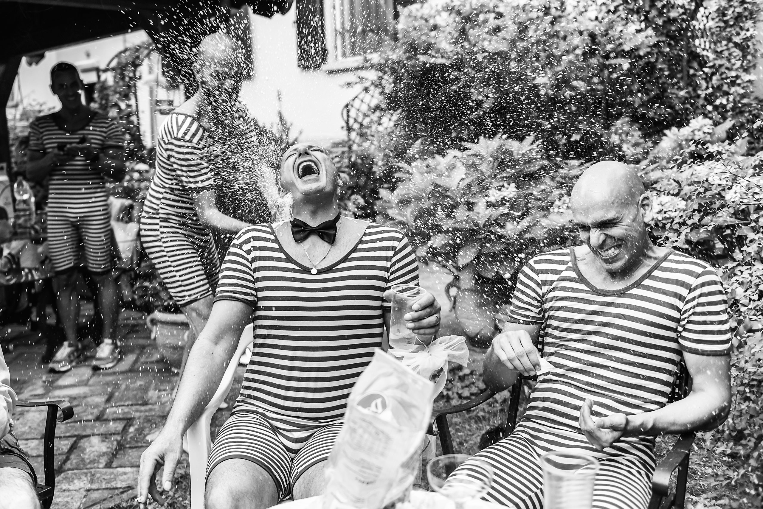 Groom and his mates playing outdoor - South London Wedding Photographer