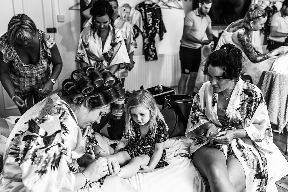 bride and bridesmaids getting ready by South London and Kent Wedding Photographer
